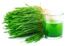 Wheatgrass juice with sprouted wheat. Isolated on white background Stock Photo