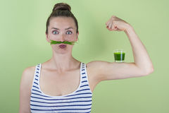 Wheatgrass power!. Strong and healthy with a wheatgrass power shot Stock Photos