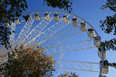 Wheel. A wheel with cabins is slowly spinning around in Copenhagen, Denmark Stock Photo