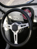 Wheel. Steering wheel interoir of an oldtimer Stock Photos