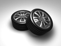 Wheel. Two isolated car wheels on white surface Stock Images
