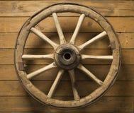 Wheel. Old cart wheel on the tree Stock Photo
