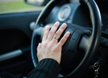 Wheel. A man with his hand on the wheel Royalty Free Stock Photo