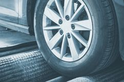 Wheel alignment and balancing. Wheel alignment and balancing in auto service stock photos