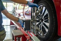 Free Wheel Alignment Of A Vehicle In Progress Royalty Free Stock Image - 165436166