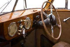 Wheel of the ancient car. Control panel in the ancient car with a right-hand wheel Stock Photo