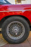 Wheel of another era. Wheel and rim that was fashionable in sports cars of another era royalty free stock photography
