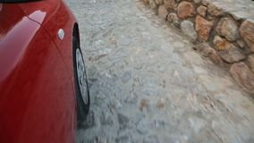 Wheel of auto riding down cobblestone road of ancient European city, tourism. Stock footage stock video