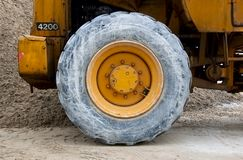 Wheel of backhoe or tractor over sand Royalty Free Stock Images