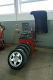 Wheel balancing machine. With four balanced summer alu wheels royalty free stock image