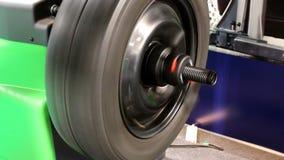 Wheel balancing machine stock footage