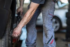 Wheel balancing or repair and change car tire at auto service stock photography