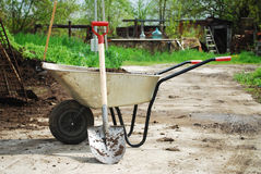 Wheel Barrow. On the land at the county with land and shovel stock image