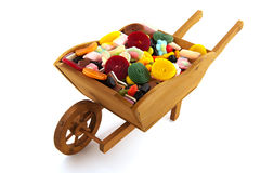 Wheel barrow with candy Royalty Free Stock Photo