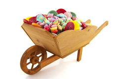 Wheel barrow full with candy Stock Photo