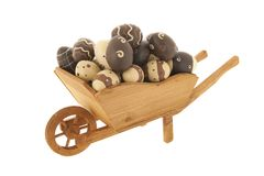 Wheel barrow with chocolate easter eggs Stock Image