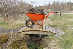 Wheel barrow full of mud Royalty Free Stock Photography