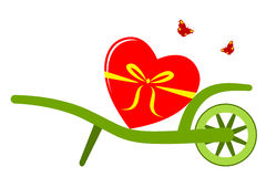Wheel barrow and heart Stock Images