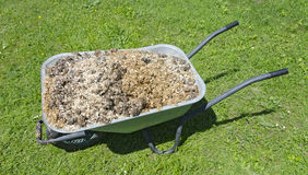 Wheel barrow with horse manure Stock Images
