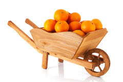 Wheel barrow with mandarins Royalty Free Stock Image