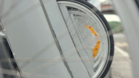 Wheel bicycle in parking lot. Bicycle wheel in t parking lot. Bicycle is parked. In city. Close up bicycle wheel stock video footage