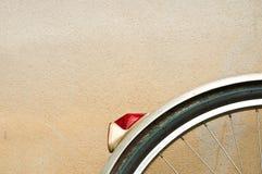 Wheel bike. On the old wall Stock Image