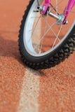A wheel of bike on the runway Stock Photo