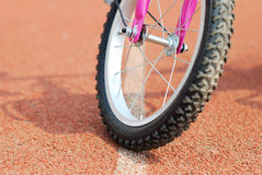 A wheel of bike on the runway Stock Image