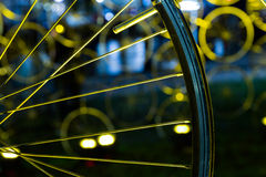 A wheel of a bike in yellow light Royalty Free Stock Image
