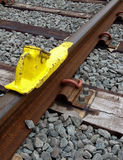 Wheel block for trains. A wheel block, placed on a track to stop a train from moving Royalty Free Stock Photo