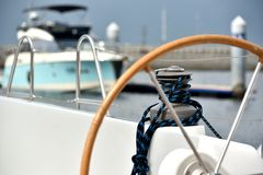 Wheel and bollard on yacht Royalty Free Stock Photos