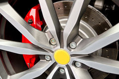 Wheel And Brake Pad. Racing Car Alloy Wheel And Red Break Pad With Ventilated Disc Royalty Free Stock Photo