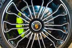 Wheel and brake system of a mid-engined plug-in hybrid sports car Porsche 918 Spyder, 2015. Royalty Free Stock Photography