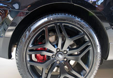 Wheel and brakes of new sport utility vehicle SUV Range Rover Evoque Royalty Free Stock Photography