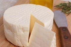 Wheel of brazilian traditional cheese Minas Stock Photos