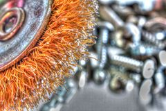 Wheel brush with screws and bolts Royalty Free Stock Photography