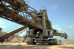 Wheel bucket in sand-mining. Big wheel bucket in sand-mining Stock Photos