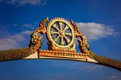 Wheel buddha. Goal wheel buddha and blue sky background Stock Photo