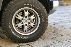 Wheel of the car with BFGoodrich tires close-up. San Marino, Italy - August 16, 2015: Wheel of the off-road Toyota car with BFGoodrich tires close-up Stock Photo