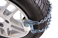 Wheel of a car with chains on snow Stock Photos