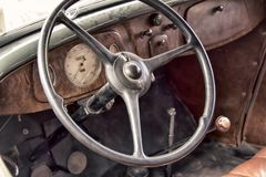 Wheel car of mid-20th century. Interior of old car (car salon stock photo
