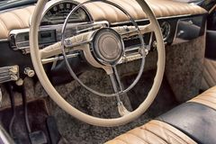 Wheel car of mid-20th century. Interior of old car (car salon royalty free stock image