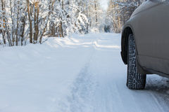 Wheel of the car is ready to go by snowy road Stock Images