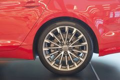 The wheel of the car of red color close up royalty free stock photo