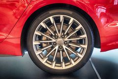 The wheel of the car of red color close up stock images