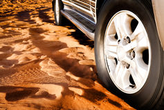 Wheel of a car on the sand Royalty Free Stock Photos