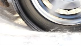 The wheel of the car slips in the snow. During heavy acceleration stock video