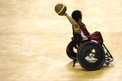 Wheel Chair Basketball for Disabled Persons (Men). A wheel chair basketball player in action in an international tournament royalty free stock image