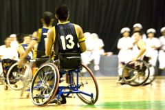 Wheel Chair Basketball for Disabled Persons (Men). Wheel chair basketball players in action in an international tournament stock image