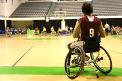 Wheel Chair Basketball for Disabled Persons (Men). A wheel chair basketball player in action in an international tournament stock images